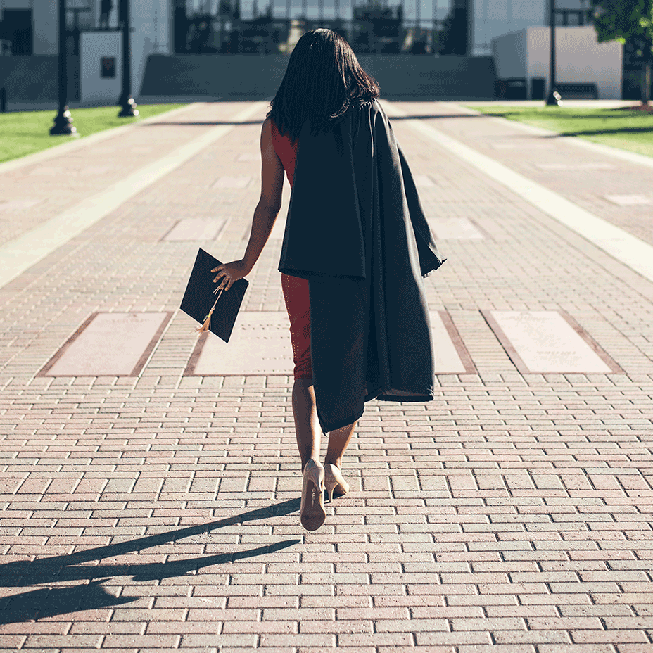 Student walking with graduation robe